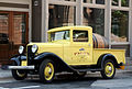 Yellow Ford beer truck.jpg