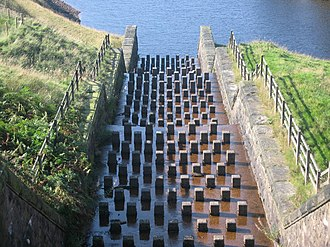 Spillway - A stepped chute baffled spillway of the Yeoman Hey Reservoir in England.