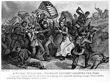 Woman waving US flag surrounded by soldiers fighting.