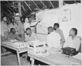 """Negro members of the 477th Antiaircraft Artillery, Air Warning Battalion, study maps in the operations section at Oro B - NARA - 531348.tif"