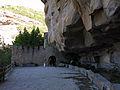 036 Balma de Sant Miquel del Fai, rec i mur del recinte oriental del monestir.JPG