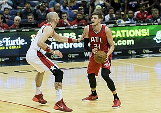 Mike Muscala - Muscala being defended by Marcin Gortat of the Washington Wizards in 2015