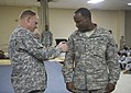 1st TSC Soldiers patch with pride in Kuwait 140526-A-XN199-003.jpg