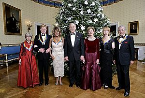 Kennedy Center Honors - 2005 Kennedy Center Honorees Julie Harris, Robert Redford, Tina Turner, Suzanne Farrell, and Tony Bennett, with President George W. Bush and First Lady Laura Bush, in the Blue Room at the White House, December 4, 2005.
