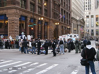 Emissions trading - Chicago Climate Justice activists protesting cap and trade legislation in front of Chicago Climate Exchange building in Chicago Loop