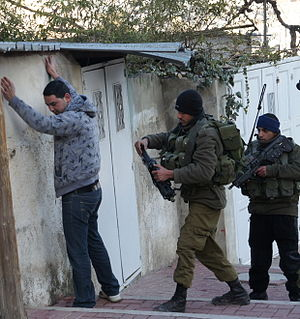 Israeli settlement - Golani soldiers searching a Palestinian in Tel Rumeida, 2012