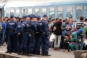 Rendőrség - Police officers guarding refugees, Budapest, Eastern Station, September 2 to 5, 2015.