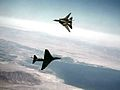 A-4F of VF-126 and F-14A of VF-111 dogfighting 1982.jpg
