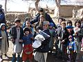 ANP, Coalition Soldiers bring smiles to children in Kandahar DVIDS74848.jpg
