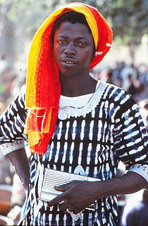 ASC Leiden - W.E.A. van Beek Collection - Dogon portraits 01 - Young man just returned from Abidjan, with his radio, Tireli, Mali 1985.jpg
