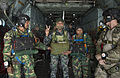 A Bangladesh Air Force (BAF) paratrooper, center, poses for a photo before a jump from a U.S. Air Force C-130 Hercules aircraft over Bangladesh during exercise Cope South 14 Nov. 12, 2013 131112-F-SI013-459.jpg