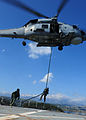 A Hellenic Navy special operations sailor fast-ropes out of a S-70B-6 Aegean Hawk helicopter assigned to the Hellenic Navy's 2nd Squadron onto the training ship Aris (A 74) at the NATO Maritime Interdiction 120517-N-QD416-051.jpg