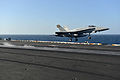 A U.S. Marine Corps F-A-18C Hornet aircraft assigned to Marine Fighter Attack Squadron (VMFA) 312 launches from the flight deck of the aircraft carrier USS Harry S. Truman (CVN 75) in the Gulf of Oman March 17 140317-N-CC806-101.jpg