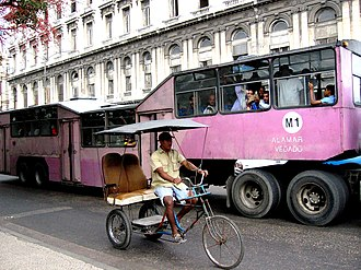 Special Period - Image: A bike taxi and large bus street scene in Cuba