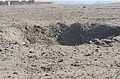 A crater remains in an open field in the Ab Band district of Ghazni province, Afghanistan, Dec. 14, 2013, after Afghan National Army Special Forces members destroyed an improvised explosive device allegedly 131214-A-ZR634-085.jpg