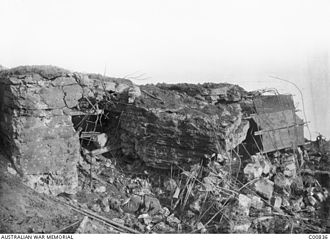 Raymond Leane - A destroyed German pillbox similar to the one near which Leane was severely wounded