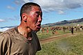 A member of the Mongolian Armed Forces walks from a decontamination area after completing a pepper spray qualification course as part of the Non-Lethal Weapons Executive Seminar (NOLES) 2013 field training 130821-M-MG222-003.jpg