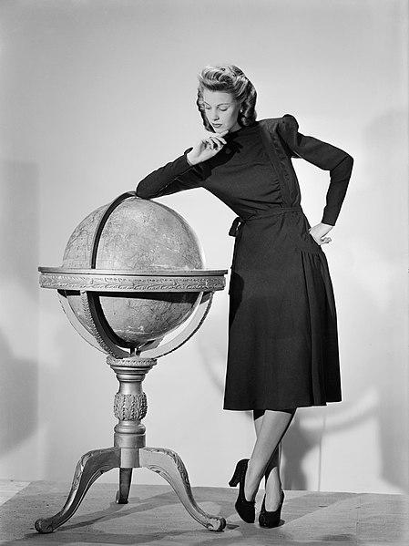 File:A model wearing a black woollen Utility Atrima dress in 1943. D14826.jpg
