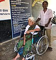 A senior citizen being escorted to a polling booth at Hulikal to exercise her franchise, during the Karnataka Assembly Election, on May 12, 2018.JPG