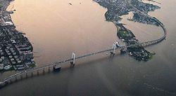 Aerial view of the Throgs Neck Bridge spanning Throgs Neck