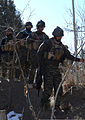 Afghan National Security Forces members with a Paktika village response unit walk down a berm after searching for improvised explosive devices and weapons caches during a clearing operation Jan. 6, 2014, near 140106-A-ZR634-124.jpg