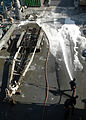 Agricultural wash-down aboard USS Carter Hall DVIDS150374.jpg