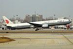 Air China, B-7869, Boeing 777-39L ER (46721697145).jpg