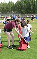 "Airman, soldiers share in ""Sports Day"" with local children 140204-Z-QD538-209.jpg"