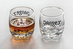 Ambigram Cognac Danger on a set of two shot glasses (full and empty).jpg