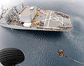 An HH-60H Seahawk helicopter from Helicopter Anti-Submarine Squadron 4 lifts a pallet of bottled water from the deck of USNS Niagara Falls (T-AFS 3) while under way off the coast of the Philippines June 29 080629-N-HX866-009.jpg