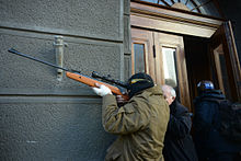 https://upload.wikimedia.org/wikipedia/commons/thumb/0/05/An_unindentified_protester_armed_with_a_rifle._Clashes_in_Kyiv%2C_Ukraine._Events_of_February_18%2C_2014.jpg/220px-An_unindentified_protester_armed_with_a_rifle._Clashes_in_Kyiv%2C_Ukraine._Events_of_February_18%2C_2014.jpg
