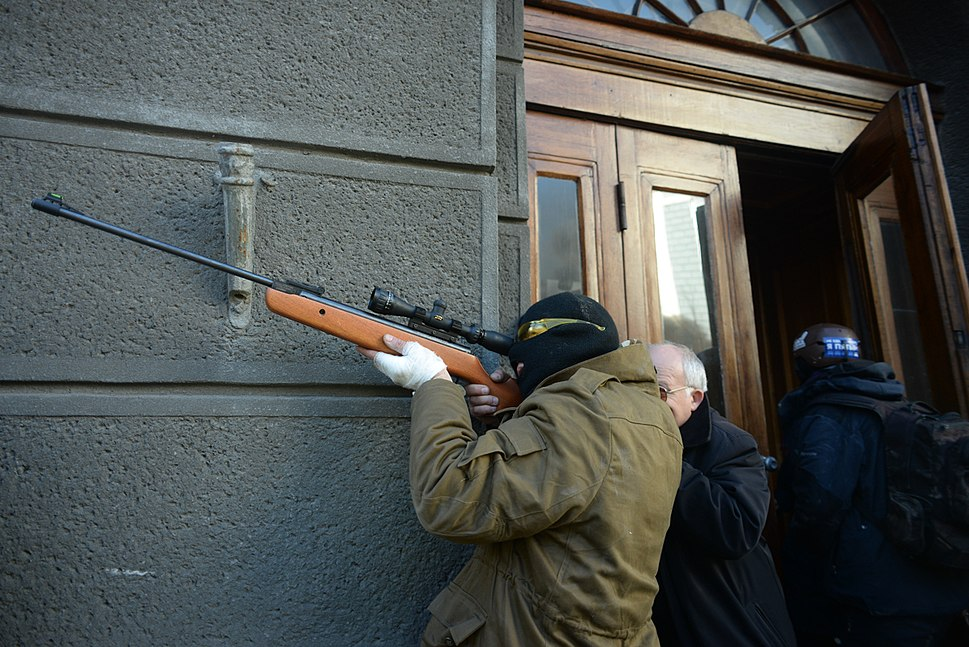 An unindentified protester armed with a rifle. Clashes in Kyiv, Ukraine. Events of February 18, 2014