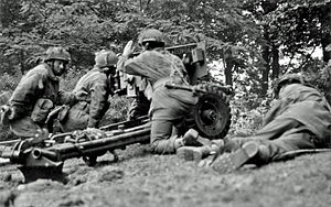 John Baskeyfield - A 6 pounder anti–tank gun of the Border Regiment engages enemy armour on the western perimeter of Oosterbeek, on the same day as Baskeyfield's action.