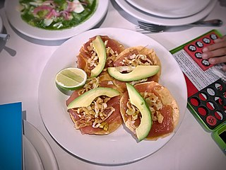 Tostada (tortilla) flat or bowl-shaped tortilla that is deep fried or toasted