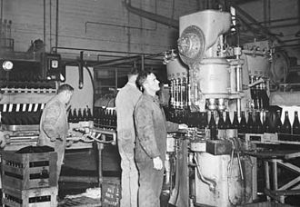 Beer in Australia - A bottling machine being used in 1945 as part of an Australian beer production operation