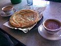 Awadhi breakfast tea with paratha.jpg
