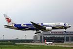 B-2059 - Air China - Boeing 777-2J6 - Blue Phoenix Livery - SHA (10329929906).jpg