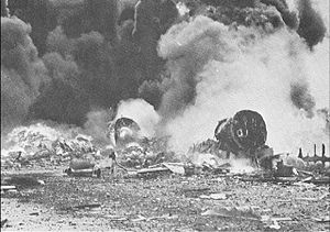Japanese air attacks on the Mariana Islands - B-29s burning at Isley Field on November 27