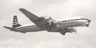 Douglas DC-7 - BOAC DC-7C G-AOIC taking off from Manchester UK in April 1958 for a non-stop flight to New York (Idlewild) (later JFK)