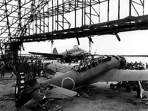 Battle of Tinian - A wrecked Japanese plane in a hangar on Tinian Island, 30 July 1944
