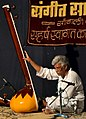 Balasaheb Mirajkar tunes his tanpura for a concert in Sangli.jpg