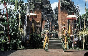 Candi bentar - Balinese dance performance in front of candi bentar and paduraksa gates.