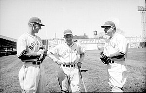 Rabbit Maranville - Rabbit Maranville (center) as manager of the Montreal Royals between two players, 1938