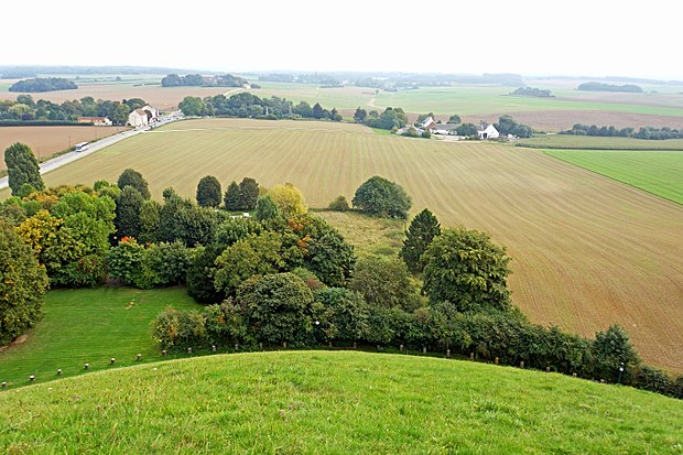 A view of the battlefield from the Lion's mound. On the top right are the buildings of La Haye Sainte. Belgium-6773 - Battlefield View (14152126362).jpg