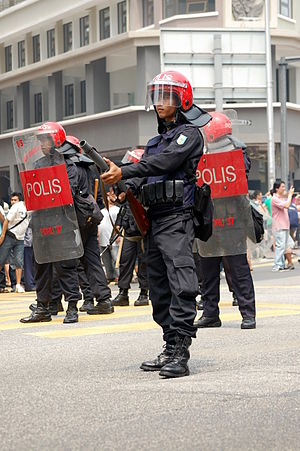 Federal Reserve Unit - A member of the Malaysia's Federal Reserve Unit prepares to disperse protesters during the Bersih Rally 2.0.