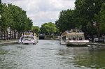 Boats pass in the wider canal, Paris 29 May 2014.jpg