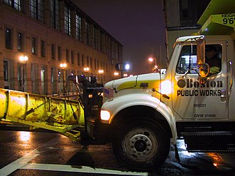 Winter service vehicle - The cab of a winter service vehicle in Boston, MA, showing the plow-frame, amber lightbar, and retroreflectors