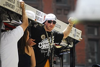 Brad Marchand - Marchand during the Boston Bruins 2011 Stanley Cup victory parade. Marchand established himself as a two-way player for the Bruins during that season.