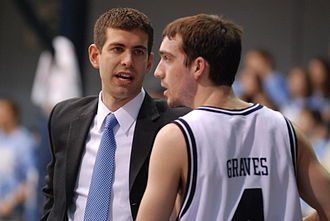 Butler University - Former Butler head coach Brad Stevens, seen here speaking with A.J. Graves, led his teams to two NCAA Men's Division I Basketball Championship games in his six seasons as head coach (2007–2013).