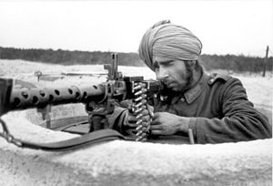 Defensive fighting position - An Indian Wehrmacht volunteer in a Tobruk DFP along the Atlantic Wall, 1944.